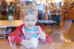 Kid eating ice cream Stock Images