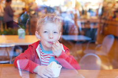 Kid eating ice cream Royalty Free Stock Photos