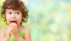 Ice cream eating by kid stock photos