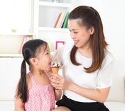 Kid eating ice-cream Royalty Free Stock Image