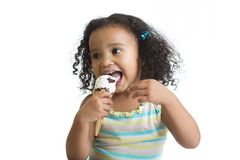 Kid eating ice cream isolated and looking aside Royalty Free Stock Photos