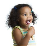 Kid eating ice cream isolated and looking aside Stock Photos
