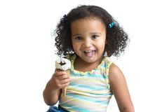 Kid eating ice cream isolated Stock Photography
