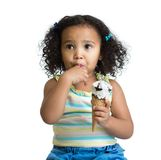 Kid eating ice cream isolated Royalty Free Stock Photo
