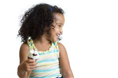 Kid eating ice cream looking aside isolated Stock Photo