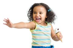 Kid eating ice cream with pointing hand isolated Royalty Free Stock Photos