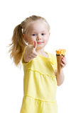 Kid eating ice cream and showing okay sign Royalty Free Stock Image
