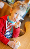 Kid eating ice-cream Royalty Free Stock Photography