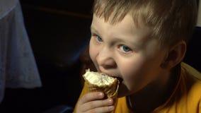 Kid eating ice cream stock video footage