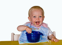 Kid eating isolated. Cute toddler eating his meal isolated on white background Royalty Free Stock Image