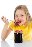 Kid is eating marmelade Stock Images