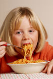 Kid eating pasta Royalty Free Stock Photography