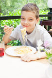 Kid eating pasta Royalty Free Stock Image