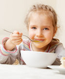 Kid eating soup Royalty Free Stock Photography