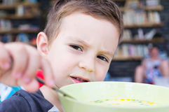 Kid eating soup Stock Photo