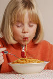 Kid eating spaguetti Royalty Free Stock Photography