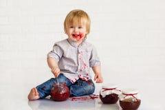 Kid eating strawberry jam Stock Photo