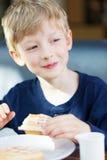 Kid eating waffles Royalty Free Stock Images