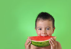 Kid eating watermelon Royalty Free Stock Images