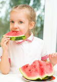 Kid eating watermelon Stock Images