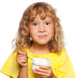 Kid eating yogurt Royalty Free Stock Photo