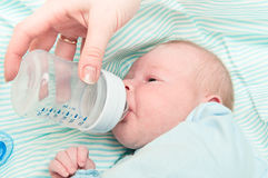 Kid eats from a bottle Stock Photography