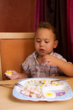 Kid eats. Royalty Free Stock Image