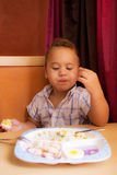 Kid eats. Royalty Free Stock Photography