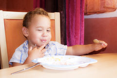 Kid eats. Stock Photos
