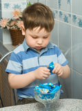 Kid eats sweets Stock Photo