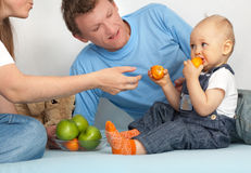 Kid eats tangerines. Royalty Free Stock Photography