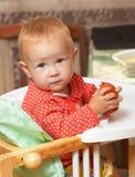Kid eats a tomato Royalty Free Stock Photo