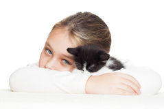 Kid  embraces kitten Stock Images