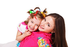 Kid embracing beautiful mother stock photography