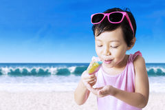 Kid enjoy melting ice cream Royalty Free Stock Photo