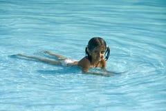 Kid Enjoying Cool Water Stock Images