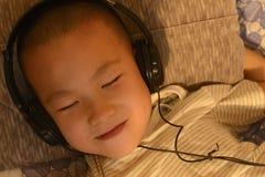 Kid enjoying music Stock Photos