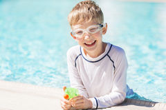 Kid enjoying the pool Royalty Free Stock Image