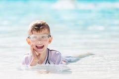 Kid enjoying the pool Stock Images