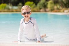 Kid enjoying the pool Royalty Free Stock Photography