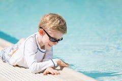 Kid enjoying the pool Stock Photography