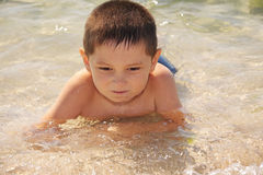 Kid enjoying sea bathing Stock Photography