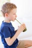 Kid enjoying smoothie Royalty Free Stock Images