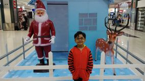 Kid enjoys Christmas decoration at airport Royalty Free Stock Photography