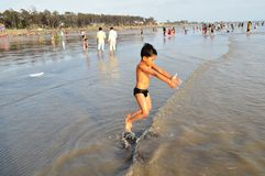 Kid enjoys at seashore. I clicked this photo during my visit at Tithal beach at Valsad. Here Yatharth enjoys playing in water at seashore royalty free stock photos