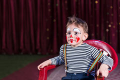 Kid with entertaining skills and clown make-up Royalty Free Stock Images