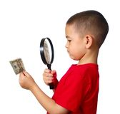 Kid examining money Royalty Free Stock Image