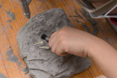 Kid excavating Spinosaurus bones Royalty Free Stock Image