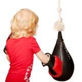 Kid exercising punching bag. Isolated on white background Stock Images