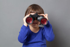 Kid exploration concept with binoculars Stock Photo
